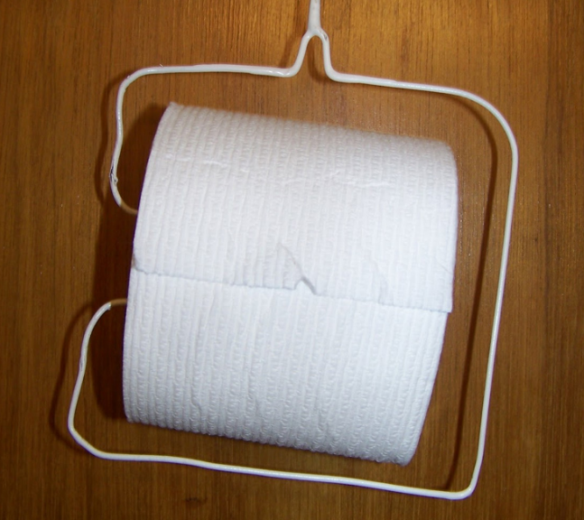 Clothes hanger toilet paper holder