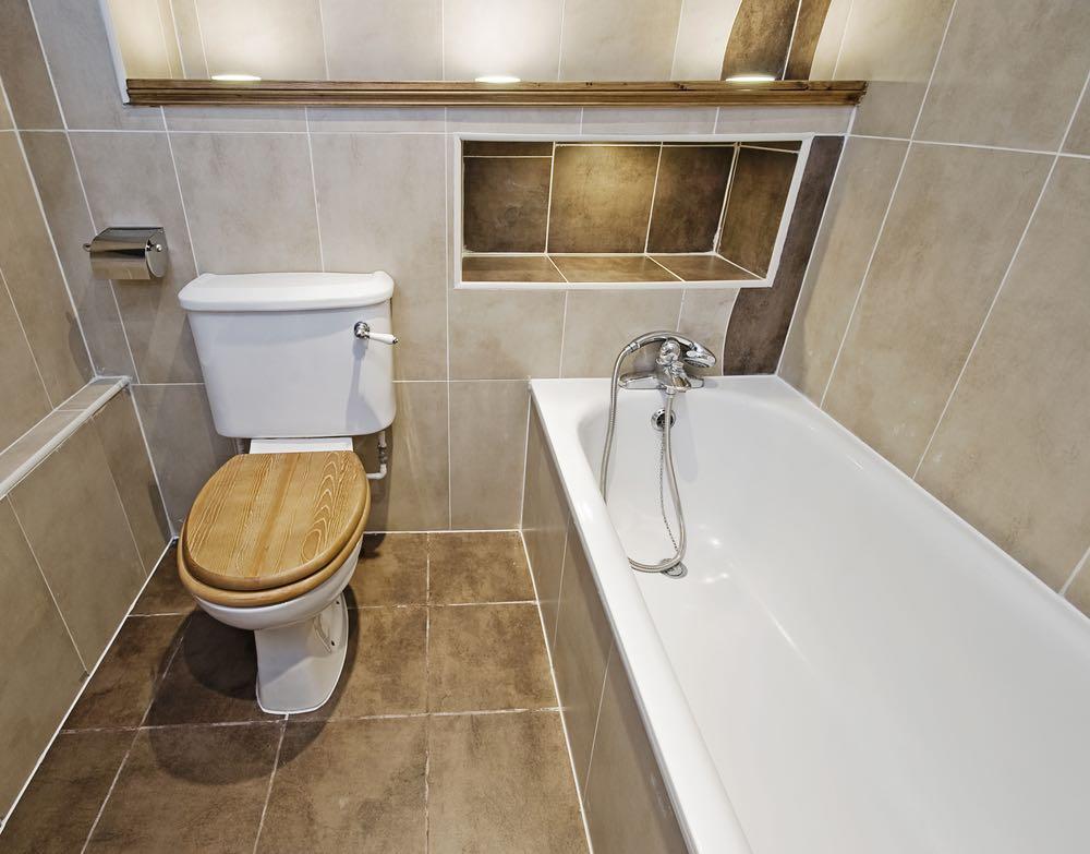 wooden toilet seat in bathroom