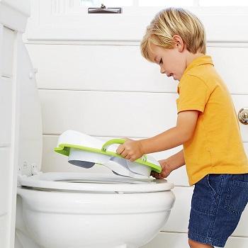 Boy Putting Munchkin Toilet Seat