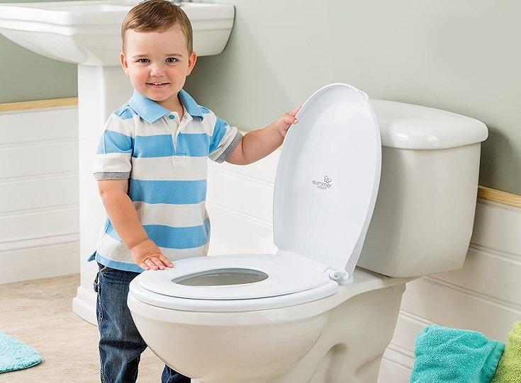 Boy Wearing Stripes near toilet
